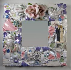 Something Old, Something New mirror of china shards, flowers, jewels, and an old wedding cake topper