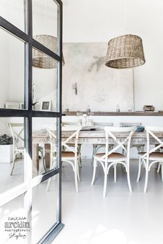 black iron doors and relaxed interior Villa Interior, Wicker Dining Chairs, Best Dining, Dining Room Lighting, Dining Room Design, Interior Design Inspiration, Interior Styling, Sweet Home, House Design
