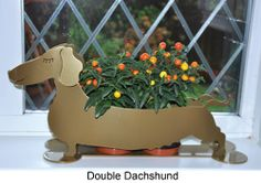 Double Daschund indoor/outdoor sculpture - a metallic #sculpture that looks good inside or outside. Perfect #gift for dog lovers  Made in the UK  http://www.madecloser.co.uk/home-garden/homeware-and-furniture/home-accessories/double-daschund