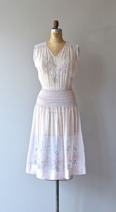 Vintage 1920s very pale pink cotton voile dress with pastel floral embroidery, smocked shoulders and waist and embroidered skirt. Metal side snaps.    ✂-----Measurements    fits like: medium  bust: 36-38  waist: 28-31  hip: up to 42  length: 44  brand/maker: n/a condition: excellent    ✩ layaway is available for this item    To ensure a good fit, please read the sizing guide:  http://www.etsy.com/shop/DearGolden/policy    ➸ More vintage dresses ✩…