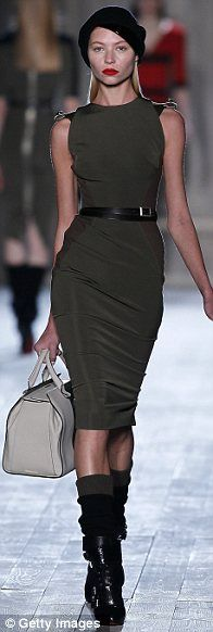 Interesting accessories: The models wore heavy biker boots over leg-warmers which had been pulled up to the knee