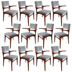 Set of 12 Carlo de Carli Dining Chairs | From a unique collection of antique and modern dining room chairs at https://www.1stdibs.com/furniture/seating/dining-room-chairs/