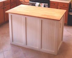 DIY butcher block cabinet - bottom island with electric outlet.  Made from unfinished kitchen cabinets for base.