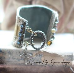 Charming, boho style, one of a kind cuff bracelet made from a vintage tin. Lined with vintage blue velvet for comfort...adorned with old lace and blue rhinestones. Closes with a handmade hook and silver ring finding. Fits a 6 wrist perfectly, but can be lengthened on request. thanks for visiting