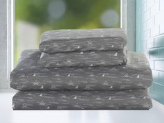 Beatrice Finn Shark Full 4 Piece Microfiber Sheet Set Gray and White | Bring the ocean to your child's bedroom with Beatrice's Finn Shark full sized sheet set. This four piece set includes a flat sheet, fitted sheet plus two pillowcases and fits double beds. Sharks and waves make up the playful pattern on a soft gray background. The fitted sheet's elasticized band and 10 inch pocket depth will keep it in place all night. #DoubleBedSheets