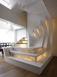 Architects: LIVE (Nuru Karim + Shyam Raheja) This is a duplex penthouse of musical architectural scale. A lyrical, dynamic, striated wall envelopes the staircase anchored within the 20 feet high internal atrium.
