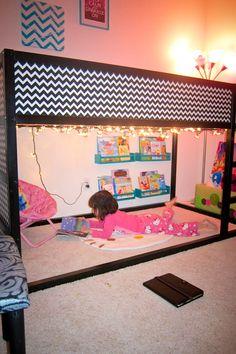 Zebra print instead of chevron...Love the blue bookshelves on the wall. So cute for the girls room!