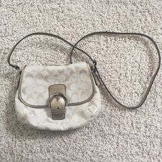 Gold coach purse Nice size gold coloring barely ever used. It has been stored away. Many pockets Coach Bags Shoulder Bags