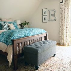 A pop of colour vamps up this master bedroom by Maggie Overby Studios. #colourpops #springshere #invitingbedrooms