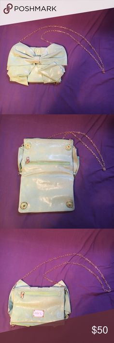 """Red Valentino CrossBody Bag Green shimmering material. Bag is gently used with slight wear throughout.  Authentic! Snap closures. Gold hardware. Measurements: 9.5""""L x 6""""H RED Valentino Bags Crossbody Bags"""