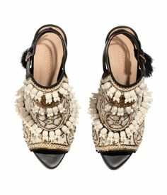 H&M CONSCIOUS EXCLUSIVE. High leather sandals with a decorated front, peep toes, embroidery in organic cotton with sequins and beads made from recycled polyester, two straps with fasteners at the ankle, and a leather lining.