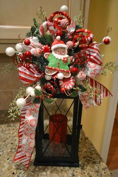 Christmas Lantern Swag. This blogger has an amazing site. Just lovely ideas for the holidays.