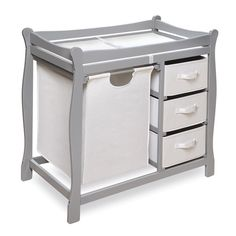 The perfect all-in-one, this changing table features safety rails and three drawers for diapers, wipes, binkies and more, while also featuring a grey finish for a gender neutral design. The convenient