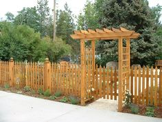 wooden fence pickets - Bing Images  like this ~ picket fence painted black, could be with metal arbor, needs gate, the along the top of the picket fence an arbor big enough for the wisteria to grow on.
