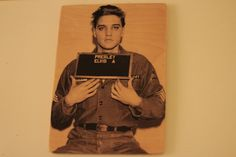 A staged mugshot —from what must be the latter portion of the King's time in the army— a young Elvis Presley left music, at one of the peaks in his career, to fulfill his duty as a soldier. Drafted in 1958, Presley quickly rose to the rank of Sergeant before being discharged in 1960. He left the army with this parting shot. His Sergeant decal on his sleeve and looks that made all the young girls swoon. The original heartthrob always knew how to knock them dead.