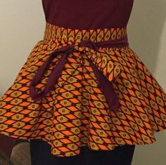 Add some flare to your fall wardrobe with our two toned Ankara print peplum belt
