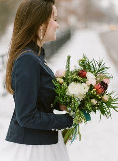 Winter bride, navy blazer with wedding dress, winter bridal bouquet by Rebecca Stewart, St. Louis winter wedding, peonies