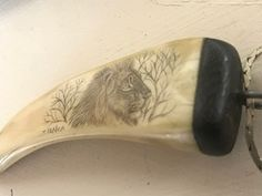 Scrimshaw Lion on unknown material