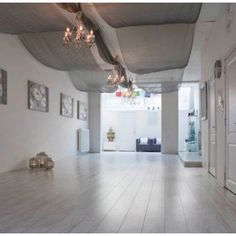 Yoga studio @ Inner Energy Shop ~ love the fabric above and chandeliers and lanterns. LOVE