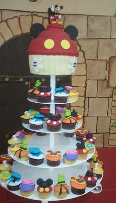 Disney cupcake tower. Each level a different Disney theme.