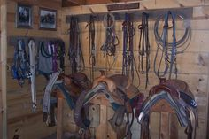 A nice, small tack room with room for a few saddles and a hanging bar for halters and bridles