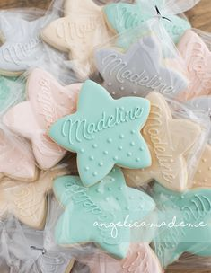 Customized pastel teal, soft pink, heather, gray and ivory cookies. Simple star sugar cookies hand decorated with royal icing.