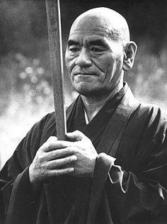 "TAISEN DESHIMARU ROSHI with The KYOSAKU (""Awakening Stick"" or ""Strike of Compassion"")"