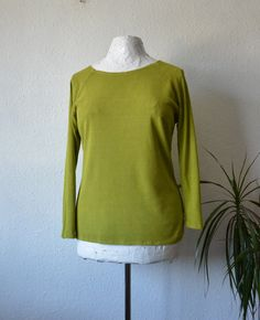 SIZING: UK 12/14, US 10/12, AUS 14/16.  Minimalist sweater top with raglan style sleeves handmade from raw silk jersey. Eco, ethical and sustainable hippie clothing for women.  This stretch fabric has a wonderful weight and texture to it - very slubby and nubby - one of my favourite fabrics.  I have dyed this garment naturally with herbs and other plant materials to an earthy yet vibrant shade of chartreuse green.  Designed with scoop style neck line and three quarter length s...