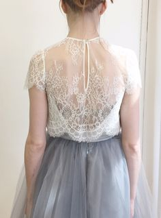 All of our pieces are responsibly made at our factory in NYC.  Our Elliot Blouse is made with the softest french-inspired lace. We love  the scalloped bottom and sleeves as well as the delicate lace motif. Pair  this top with our Gretta Tulle Skirt or over a simple cami paired with your  favorite jeans. ***Camisole in photo is not included - this is for the lace  top only.    Sizing:  The fit is loose and the measurements below were taken from underarm to  underarm with the garment…