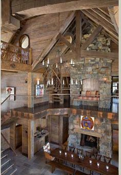 Look closely!  This soaring 3 story log home has a reading nook built into the second floor chimney!  I bet this is the warmest spot in the house when the fire is going!  Very, very clever!