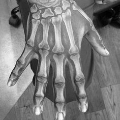 Realistic looking colored hand tattoo of bone hand