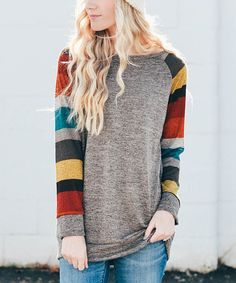 Create a casual-chic look with this top that sports a loose fit and a trendy color block design.
