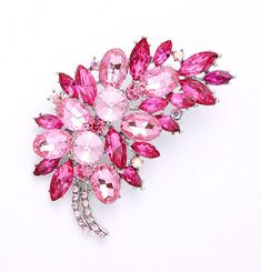 Rhinestone pink broach wedding bridal jewelry embellishment, which can be used for your DIY project - purple wedding bridal brooch bouquet, ring pillow, invitations, cake decorations, event decor, crafts, scrap booking and much more!  Size: 2 3/4 inch high 1 3/4 inches wide Rhinestone color: Pink, light pink, iridescent pink Metal: Silver  Available in HOT PINK - https://www.etsy.com/listing/233580819/pink-brooch-jewelry-embellishment-bridal  More PINK brooches…
