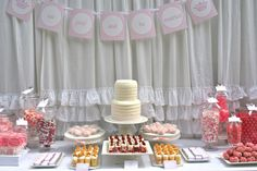 Dessert/candy bar! Provide small takeout boxes and guests can fill them up with sweets as favors! I would like the candy to be a rainbow of colors to add whimsy to a vintage glam wedding.