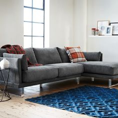 the floating couch, dark with subtle chrome footing. Looks comfy! Modular Sofa Bed, Scandinavian Interior Design, Modern Buildings, Floor Rugs, Couch, Sofa Beds, Table, New Homes, Lounge