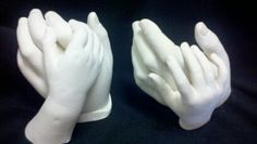 Hand molds of parent and child made with alginate and plaster. A lasting memory...
