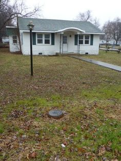 A quaint stucco bungalow near HISTORIC DOWNTOWN area! This would be a great fixer-upper for a small family or couple. Also, a great INVESTMENT PROPERTY for anyone wanting to acquire rental property! Motivated seller!! in Mountain Grove MO