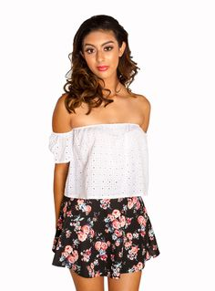 We all love a cute skater skirt but this one tops our list! This black circle skirt features printed rose bouquets throughout and an elastic waistband. No zips or closures. Model is wearing size small