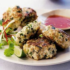 Thai Chicken Cakes With Sweet Chilli Sauce Recipe Main Dishes with boneless skinless chicken breasts, garlic cloves, fresh ginger root, onion, fresh coriander, green chilies, olive oil, red chili peppers, lime wedges, spring onions, sweet chili sauce