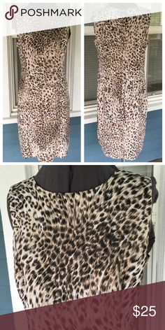 "SPIEGEL Leopard Sheath Dress SPIEGEL Leopard Sheath Dress.  Sleeveless.  Tan/black leopard animal print polyester material.  Pit-to-pit 20"".  Waist 34"".  Length 39"" (shoulder to hem).  Great condition. Spiegel Dresses"
