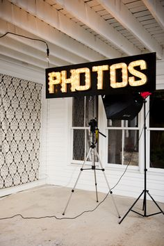 We made our Photo Booth sign using DIY marquee letters (as shown here: http://greenweddingshoes.com/diy-marquee-letters/ © www.khakibedfordweddings.com