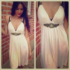 I just added this to my closet on Poshmark: ⚡️SALE⚡️ White dress with green crystal/stone. Price: $38 Size: S