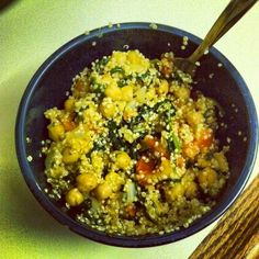 My creation--roasted tomatoes and chickpeas with spinach, kale, sauteed onions and quinoa cooked in olive oil, and seasoned with herbs, pepper and garlic powder.