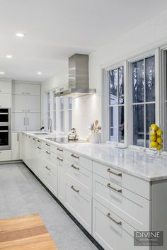 Large white kitchen design with Miele appliances
