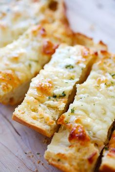 Cheesy Garlic Bread - Turn regular Italian bread into buttery and cheesy garlic bread with this super easy garlic bread recipe that takes only 20 mins.