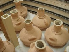 Hand-built project - ready to be fired. These Roman-style flasks were created by a class from the Norman Howard school in Rochester.