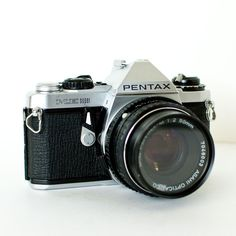 Pentax ME Super SLR 35mm camera with 50mm f2 lens and UV filter. $46.00, via Etsy.