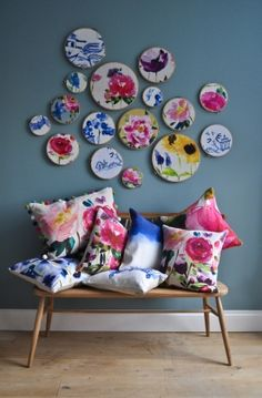 embroidery hoops with fabric - so pretty! I'll take the ...blue ones, please! thankyou!