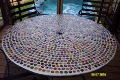 New project for our tree stump in our backyard - mosaic bottle cap table top. Good thing my husband loves beer!!