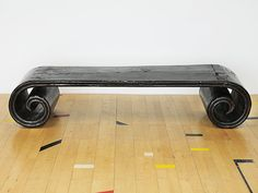 A decorative and original table with crackled thick black lacquer covering the wood. It has huge dovetail joints and a double moulded edging.